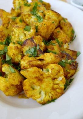 Add the health benefits of turmeric to your meal with this spicy roasted cauliflower recipe