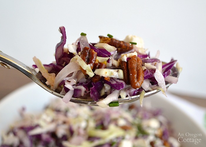 Shaved Cabbage Salad with Creamy Feta Vinaigrette on spoon.