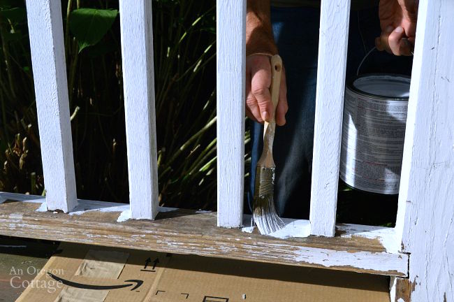 Repaint porch railings-applying quality primer