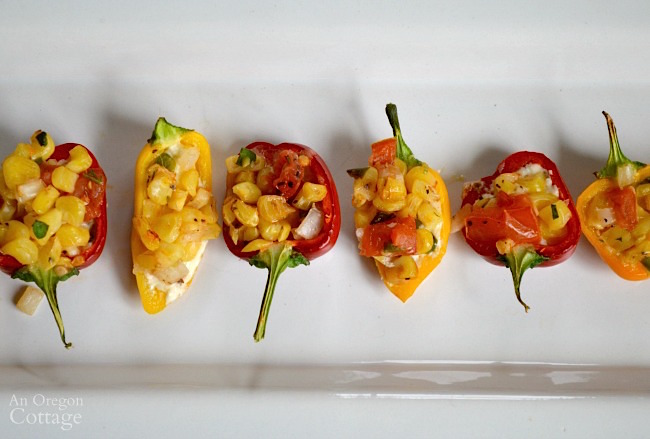 Cheese-Stuffed Mini Peppers with Roasted Corn Salsa make a perfect light appetizer.
