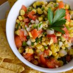 Make a quick & delicious roasted corn salsa in just a few minutes using frozen corn. It's perfect as an appetizer or topping for salads, tacos and more!