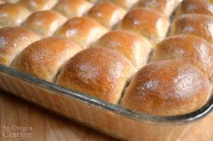 Buttered tops of freshly baked whole wheat dinner rolls