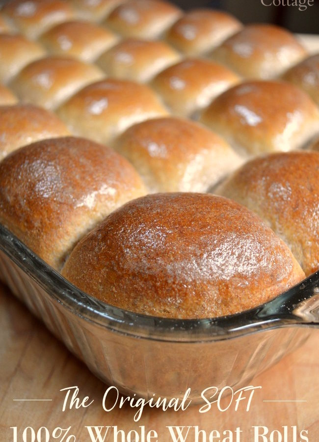 Buttered whole wheat dinner rolls in baking pan.
