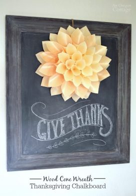 Make a simple wreath with hot-glued wood cones to anchor a Thanksgiving Chalkboard.