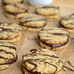 Up your shortbread game by sandwiching easy roll-and-slice shortbread cookies with a delicious dark chocolate ganache. Perfection with coffee or tea!