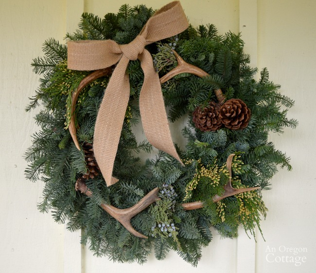 Natural and neutral Christmas porch wreath with antlers and burlap bow