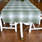 You won't believe how easy it is to make a fringed table runner to go with your decor - it's just a matter of pulling threads! This works with plaid, burlap, and any type of cotton fabric with a thicker weave. Make a no-sew fringed table runner today!
