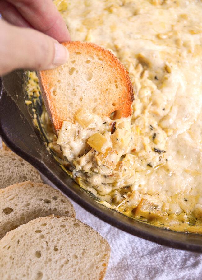 Cheesy Chicken Artichoke Skillet Dip_scooping
