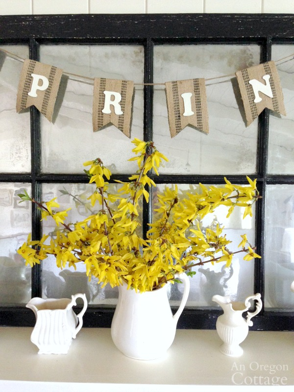 Spring mantel with blooming forsythia