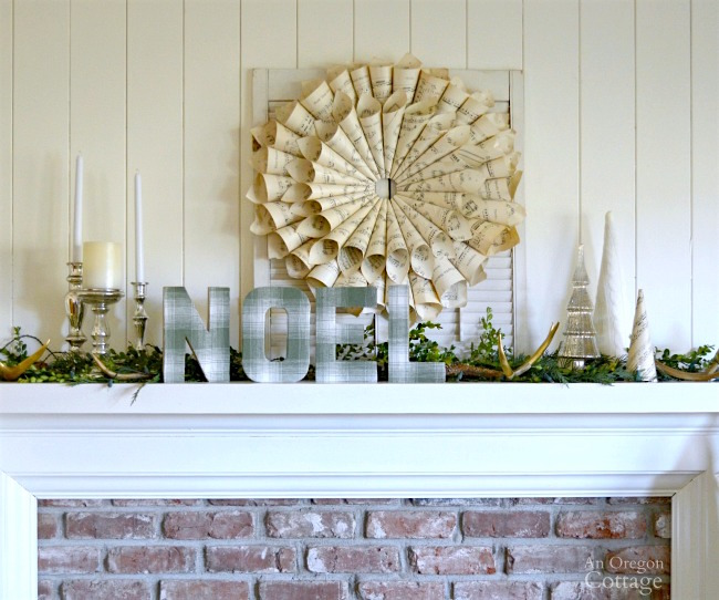 Use vintage sheet music for a DIY wreath and cone tree then add candles, more trees, greens and oversized letters.
