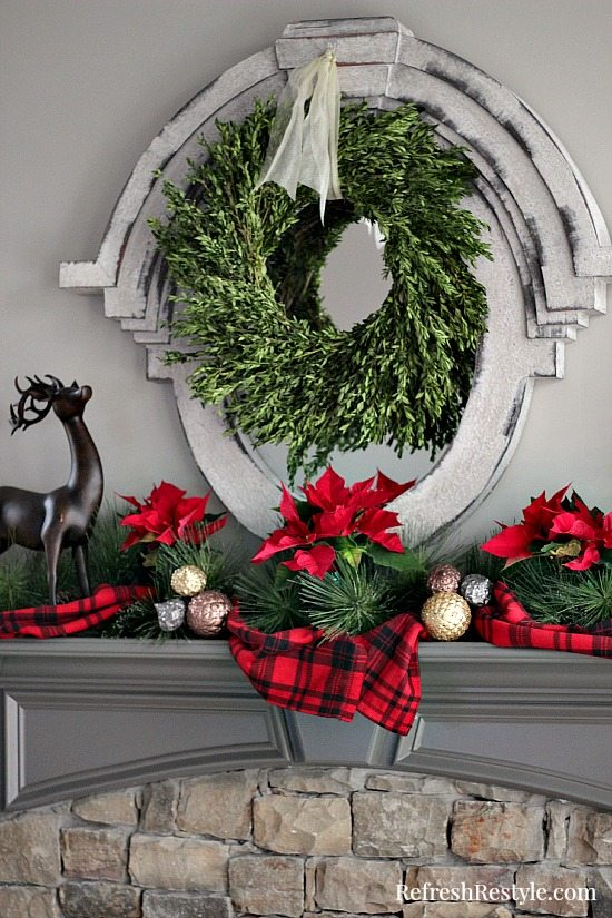 red-christmas-mantel-with-boxwood-wreath-at refreshrestyle.com