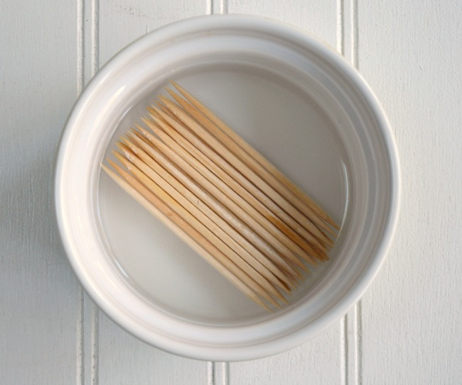 Soaking toothpicks for Maple Mustard Bacon Chicken Bites