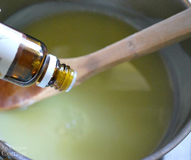 Adding essential oil to homemade hand cream