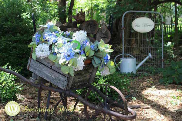 Container Gardening Ideas for Shade-Hydrangeas in apple-crate-wheel-barrow at Designing Wilder