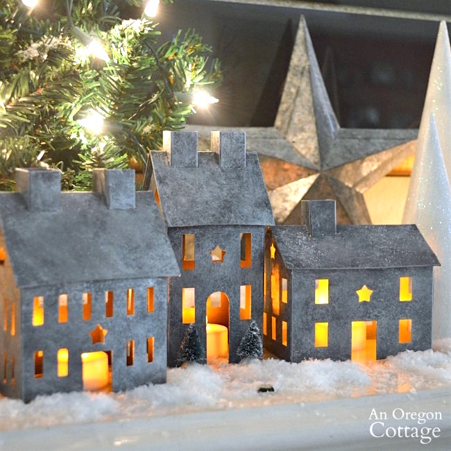 Faux galvanized finish metal village houses lit with candles