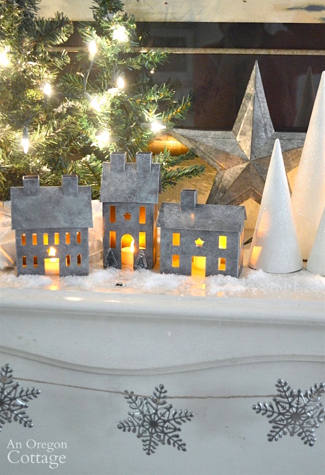 Faux galvanized finish metal village houses with candles
