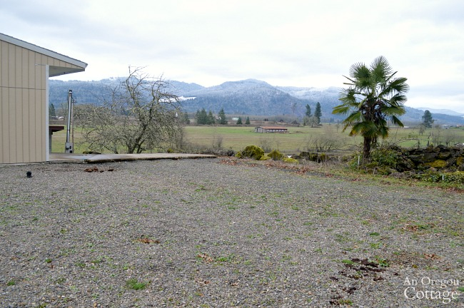 Gravel area of future garden with hills in the background