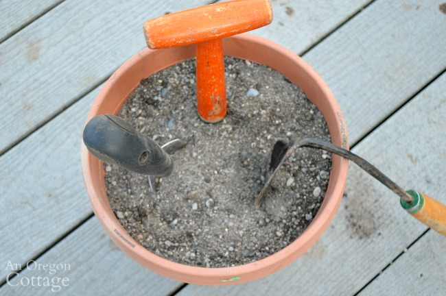 Steps to Care for Garden Tools-storing tools in pot of sand