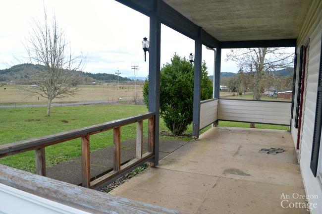 Farmhouse porch view into yard
