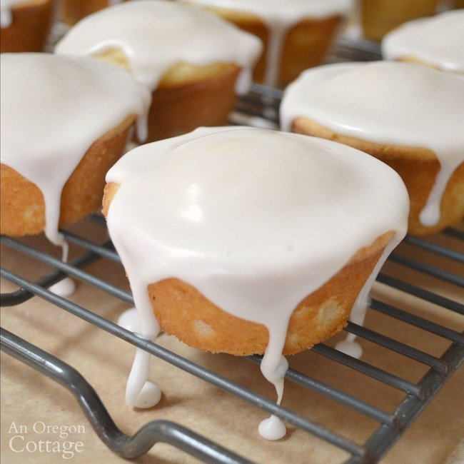 Glazed lemon cupcakes on rack