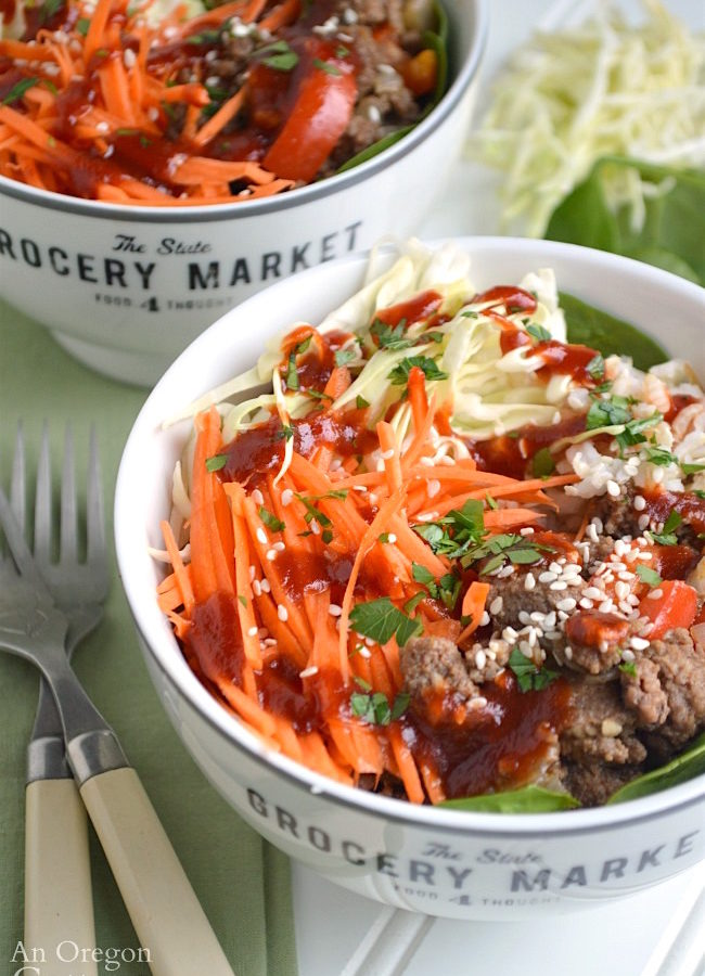 Bowls with beef, vegetables and rice