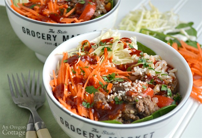 Bowls full of beef, vegetables and rice