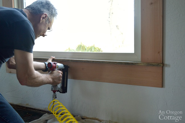 Attaching bottom board for 1920s farmhouse window trim DIY