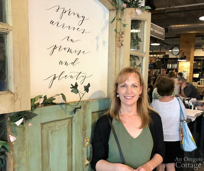 Standing in front of door display at Magnolia Market