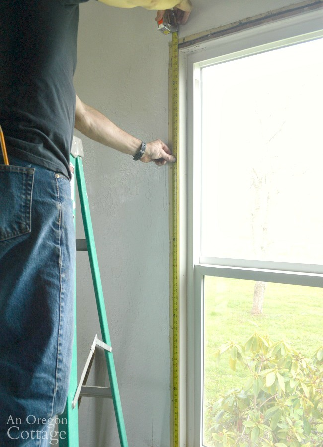 Measuring for 1920s farmhouse window trim DIY