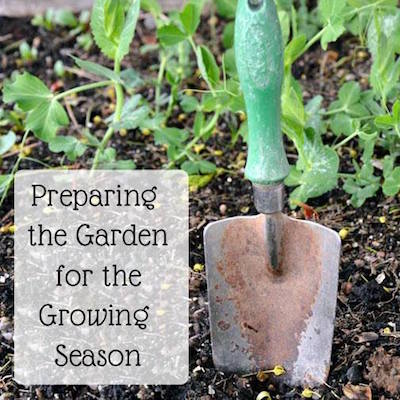 Prep garden for the growing season-shovel in dirt
