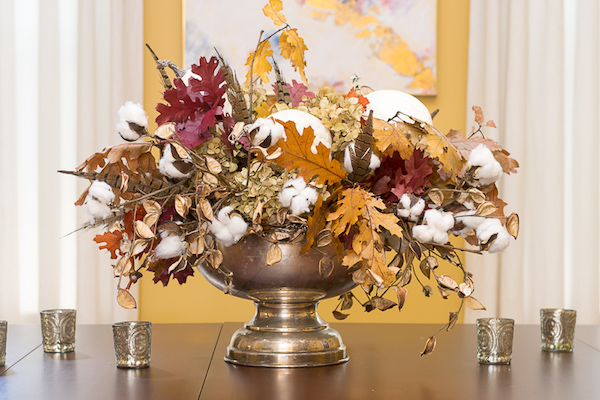 Nourish and Nestle-fall-centerpiece with gourds and leaves