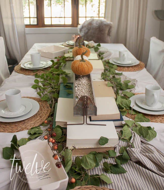 Twelve on main-farmhouse-tablescape-with-books