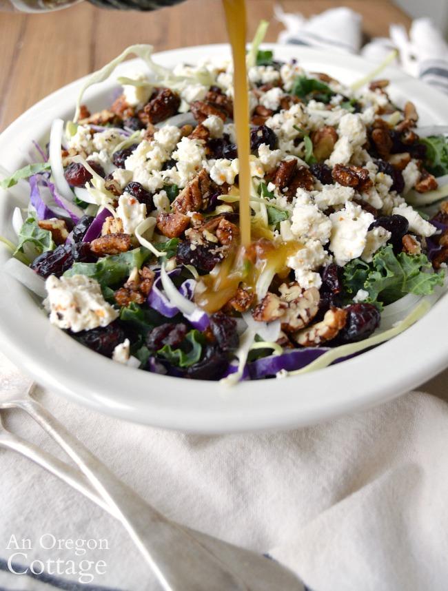 Kale Cranberry Salad-pouring dressing