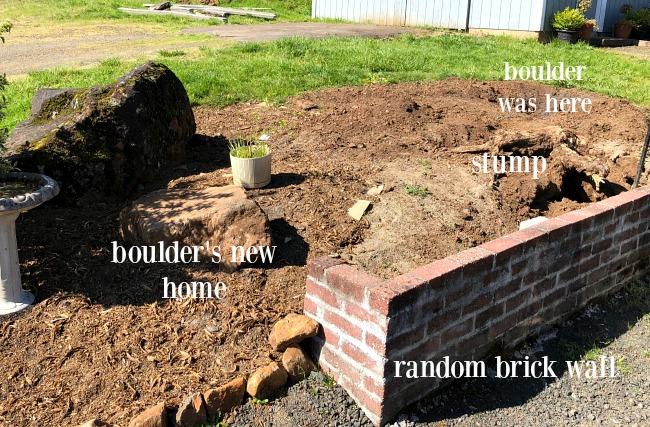 Mound and brick wall garden area