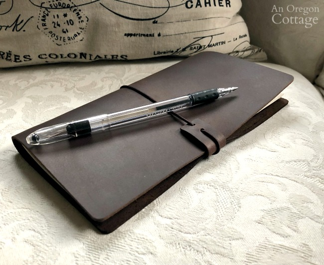 Leather travelers notebook on chair
