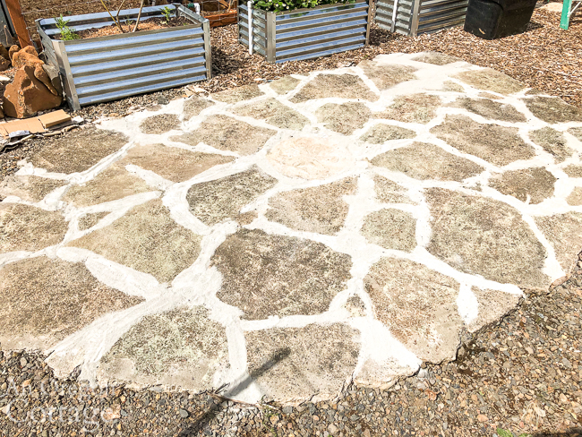 broken concrete patio with filled spaces