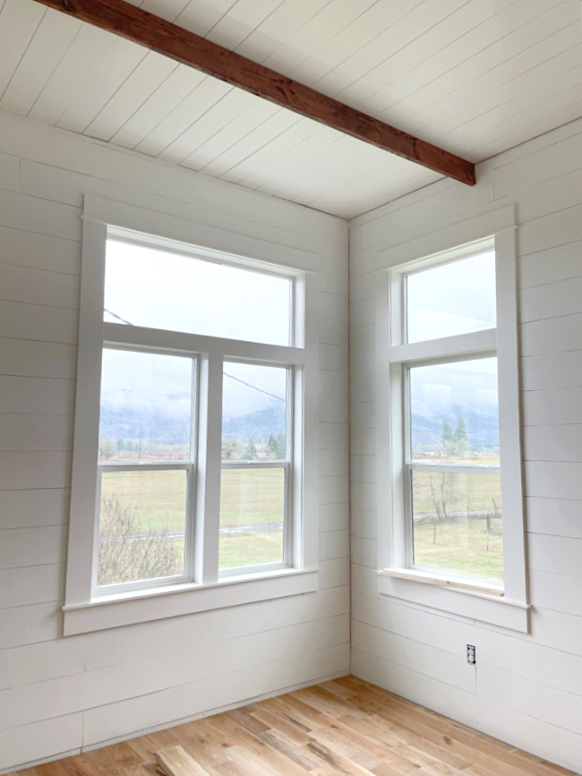 farmhouse master bedroom with ceiling beam