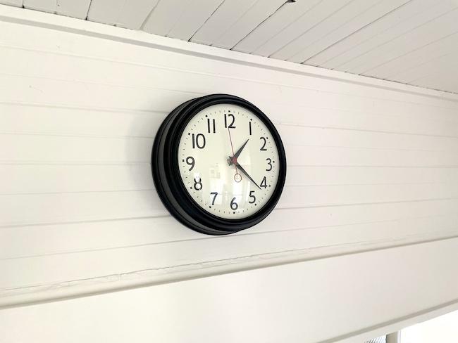 retro wall clock on beadboard wall