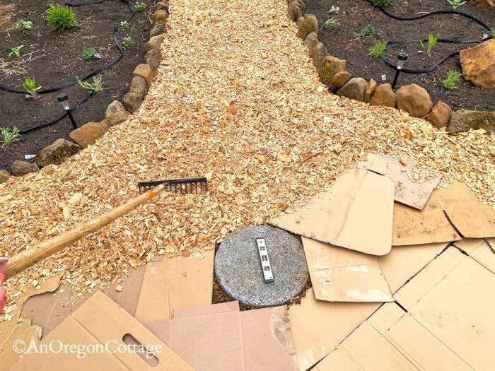 laying bark paths-leveling birdbath stone